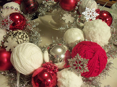 i looked in my christmas storage old balls yarn and old silver decorations i remade the silver tinsel wreath with lots of red in yarn and glass balls