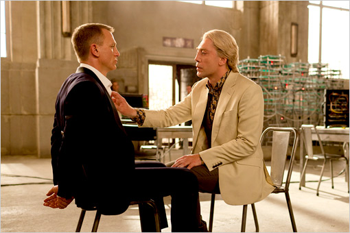 James Bond being touched by Javier Bardem in Skyfall movieloversreviews.blogspot.com