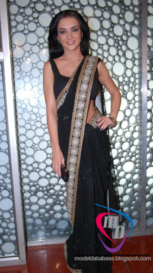 Spicy bollywood actress amy jackson in a black transparent saree ...