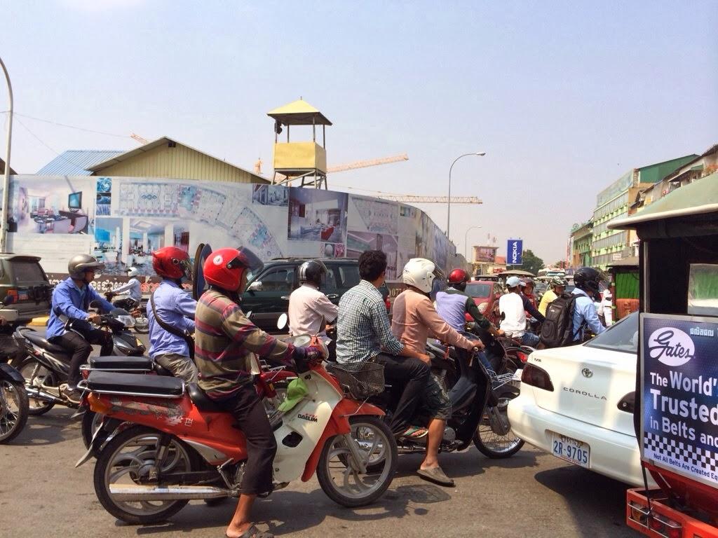 phnom penh traffic Cambodian prime minister hun sen (c) rides a motorbike along a street in  phnom penh, june 24, 2016 afp cambodian civil society groups.
