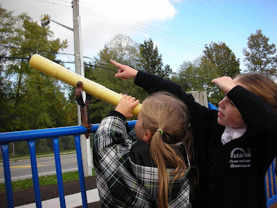 girls with telescope autumnal fall equinox NAMC montessori activity ideas