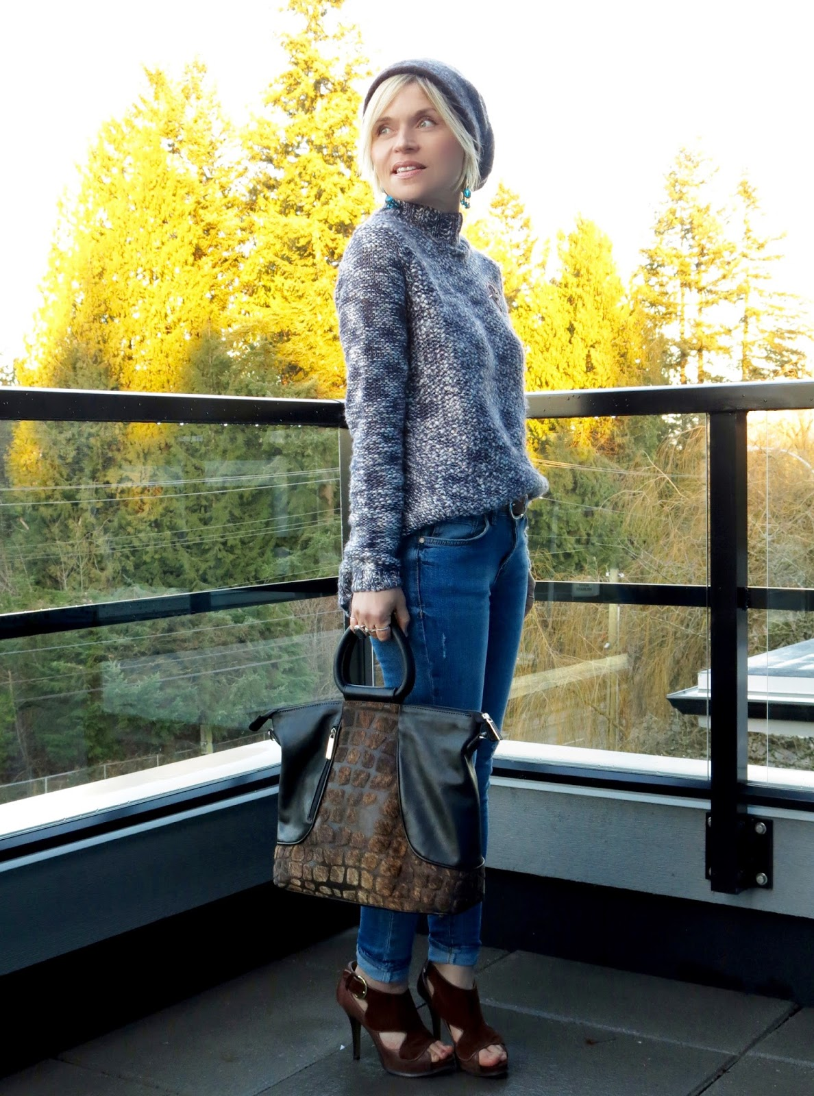 styling a chunky, split-back sweater with skinny jeans and a woolen beanie