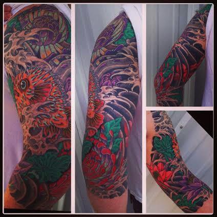 Pufferfish sleeve tattoo by tattoo artist Jason Kunz for Triumph Tattoo
