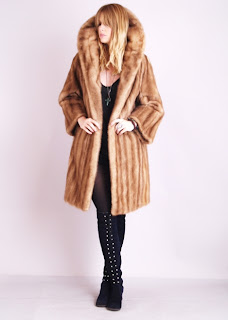 Vintage 1960s honey brown mink coat with large collar.