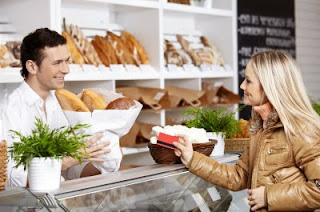 woman buying bread at a bakery