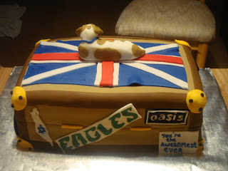 30th Birthday Suitcase Cake with Philadelphia Eagles, Oasis band, and Israel stickers