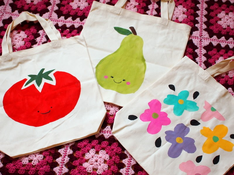 freezer paper stenciled tomato, pear, and flower canvas bags