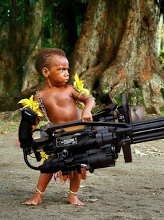 funny weapons fail picture child soldier with minigun