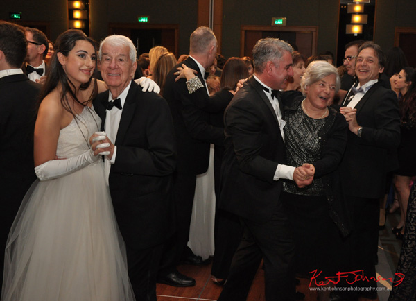 Débutante Ball at the Four season Sydney, families dancing together. Photography by Kent Johnson.