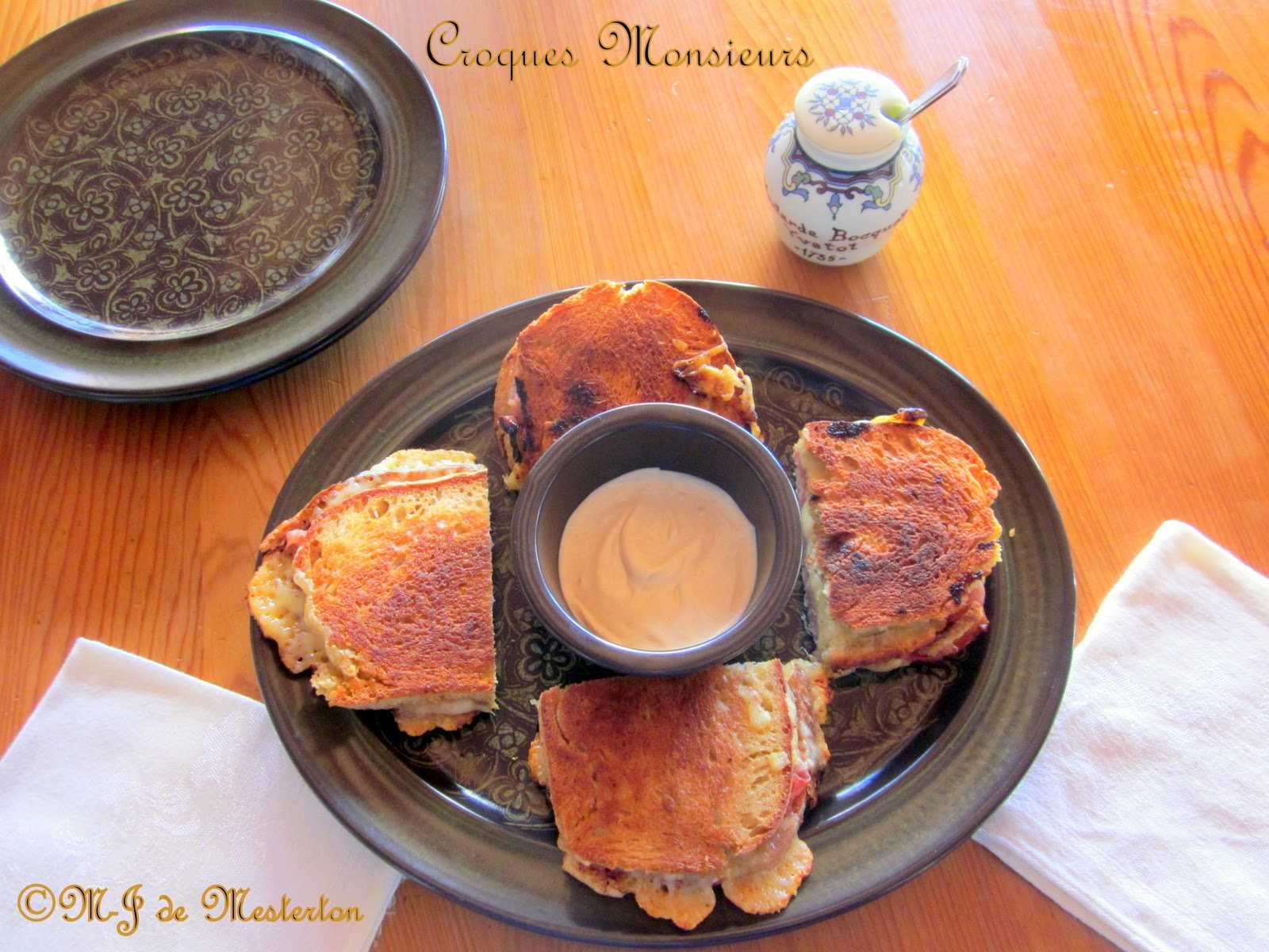 Serve croques monsieurs with mayonnaise and Dijon mustard on the side.
