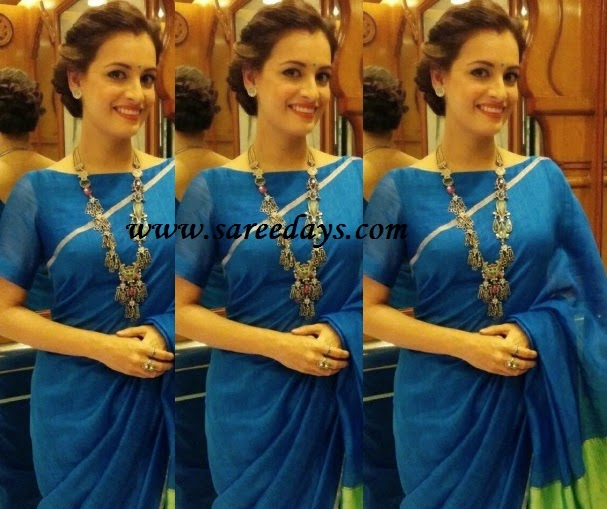 Latest saree designs diya mirza in blue simple designer saree checkout diya mirza in blue simple cotton designer saree with small zari border and paired with matching short sleeves blouse with wide open neck pattern thecheapjerseys Images