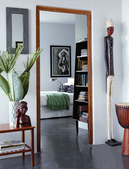 Safari Fusion blog | Quirky colonial men | A super tall Colonial Man statue guarding the doorway to a bedroom
