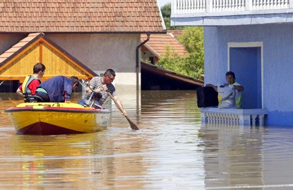 These 16 photos will disturb you... The Balkans in the grip of flood! - A man waits to be rescued from his house during heavy floods in Vojskova, May 19, 2014.