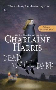 Cover art for Dead Until Dark by Charlaine Harris, featuring a blonde person and a dark-haired vampire hovering over a farmhouse
