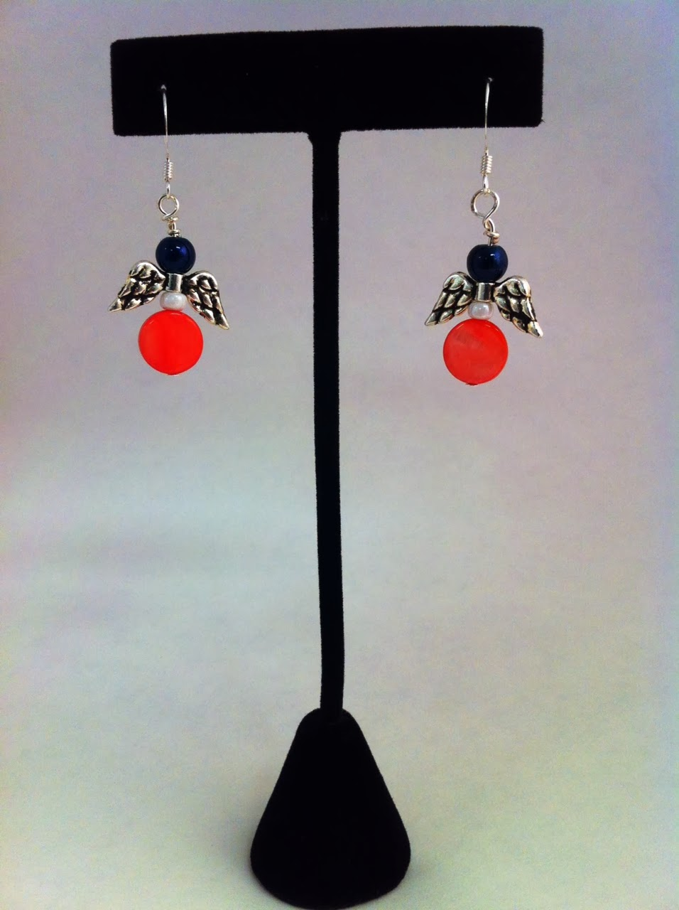https://www.etsy.com/listing/181123820/angel-coral-and-navy-silver-earrings