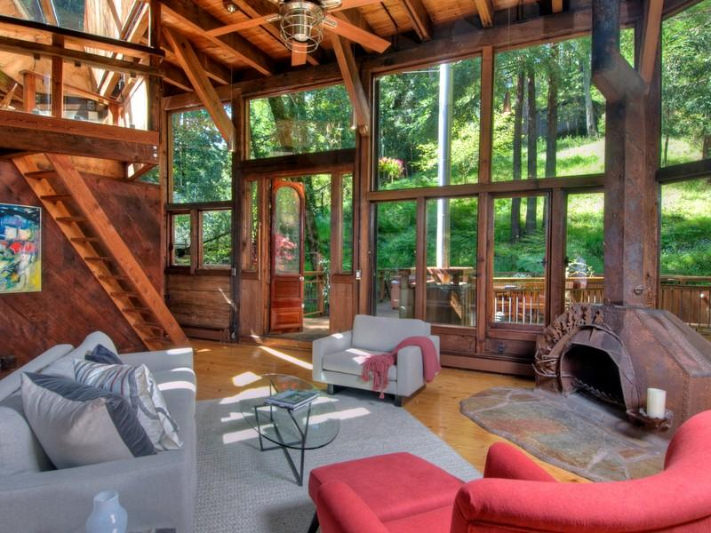 photo of living room during the day inside of tree house in the forest
