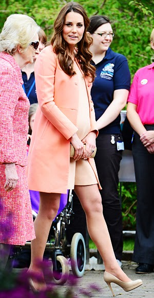 Catherine Middleton wears a peachy Tara Jarmon coat on her two-year wedding anniversary, April 2013