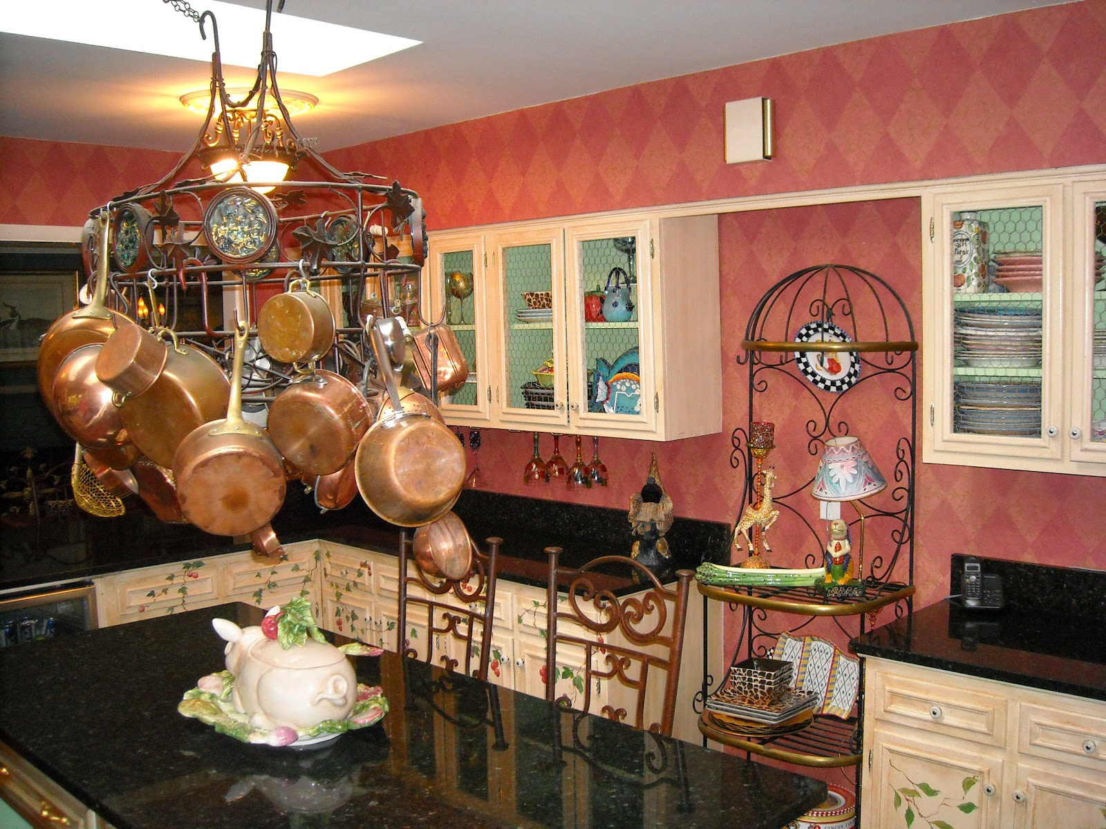 cabinets, I put beautiful Salmon colored Thibaut wallpaper on the