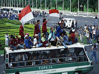 Students protesting on a bus