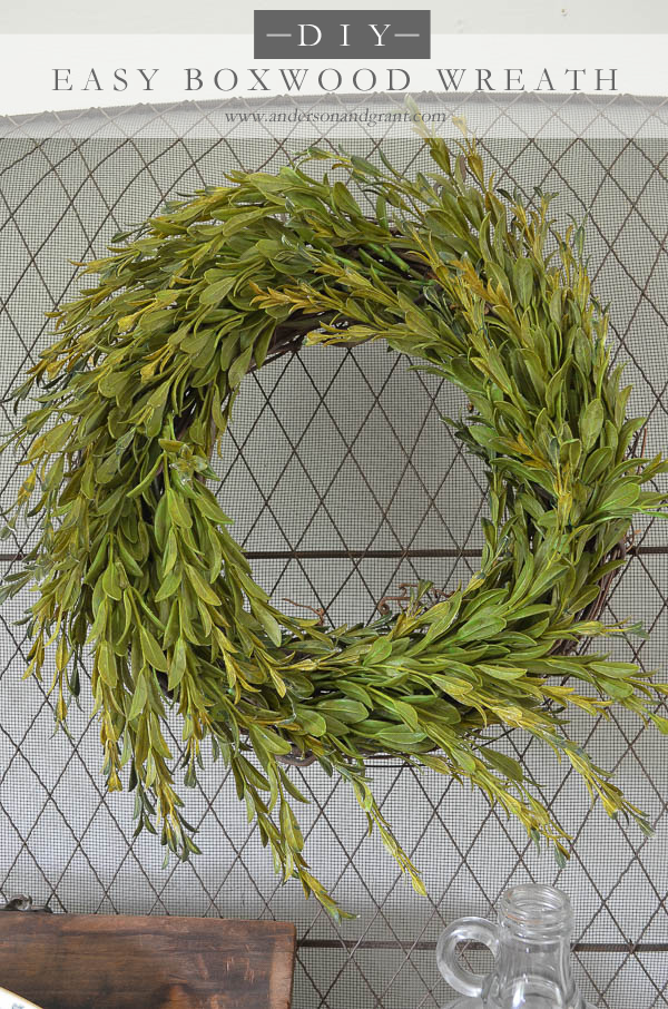 Create your own beautiful boxwood wreath for under $15!  DIY Tutorial at www.andersonandgrant.com  #wreath #DIY #decorate