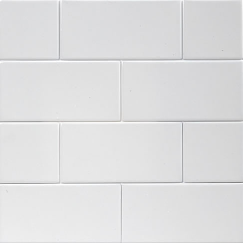 white subway tile in shower of master and shower bath in guest bath