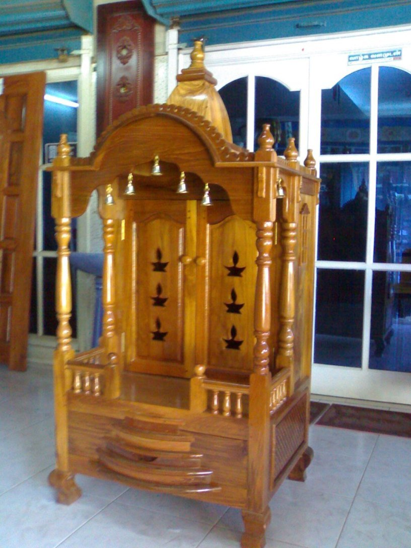 kerala style Carpenter works and designs Pooja Room  : PoojaMandir from woodinteriordesigns.blogspot.com size 816 x 1088 jpeg 147kB