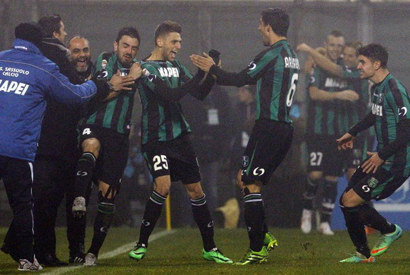 Domenico Berardi celebrates after scoring his and Sassuolo's fourth goal against AC Milan