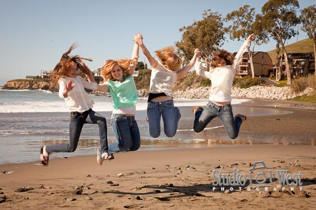 Jumping girl cousins at Cayucos Beach