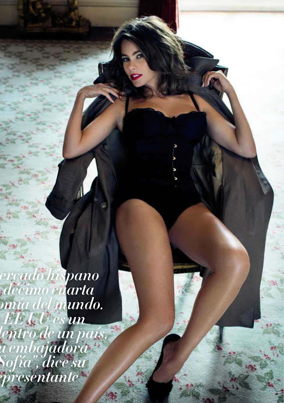 Sofia Vergara leggy in a black corset sitting in a chair