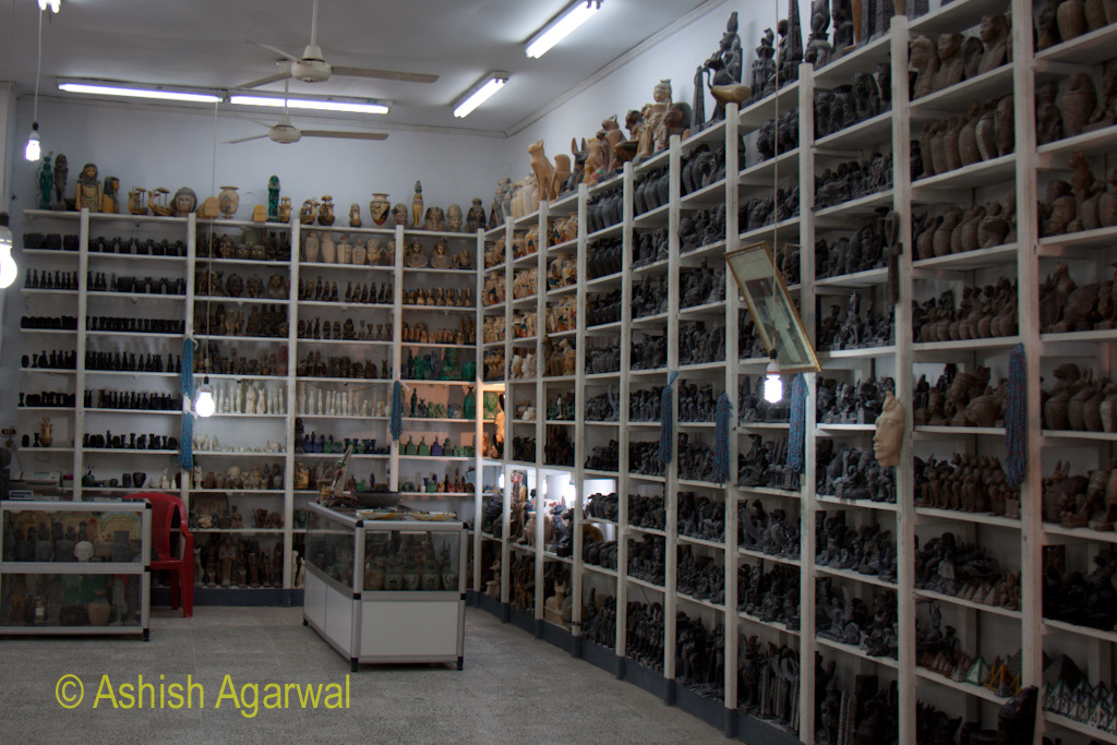 Stacks of curios lined up for sale on shelfs, in a small shop and exhibition place near the Valley of the Kings