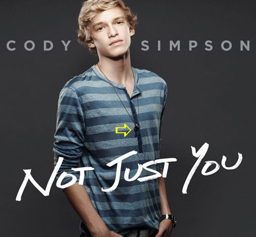 Cody Simpson wearing a Jenny Dayco necklace