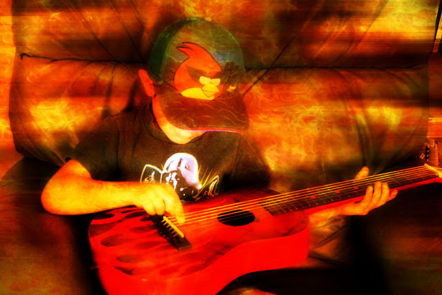 boy playing guitar photo edit