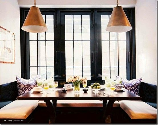 black built in banquette kitchen seating gold cone pendant lighting