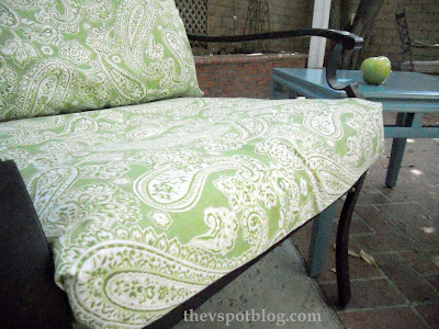 How to temporarily recover outdoor furniture cushions with a glue gun.