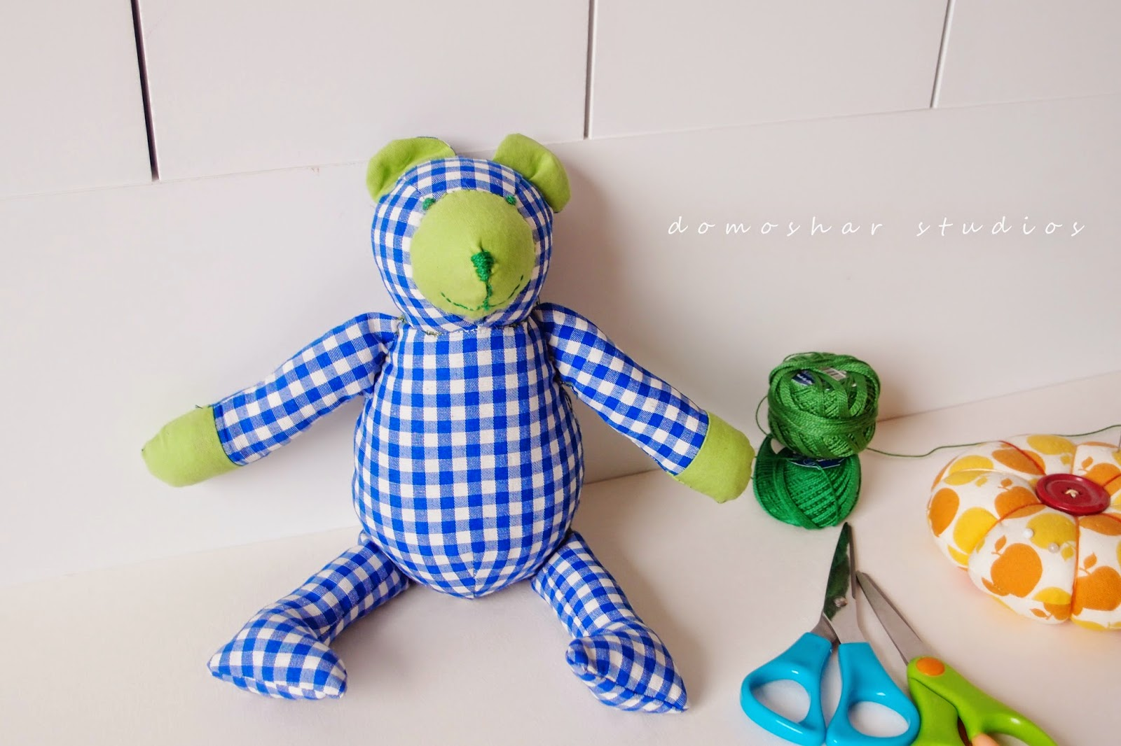 mini bear doll in checks
