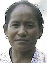 Headshot of a middle-aged Bhutanese woman with her hair pulled back and a faint smile on her face