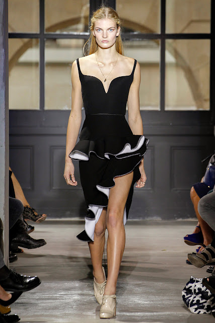 Monochromatic ruffles on a v-neck dress with asymmetric hem, by Balenciaga
