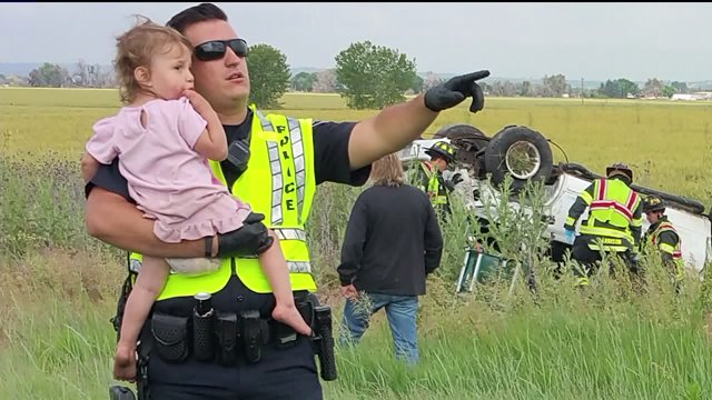 Nick Struck - The singing policeman comforting the little girl