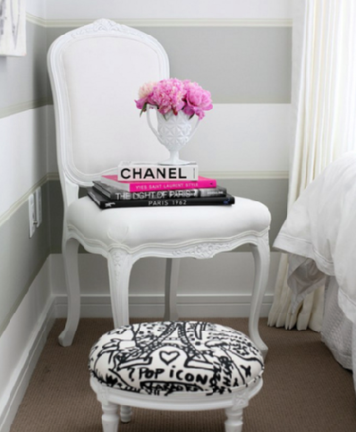 an accent chair can be the foundation for an artistic display of books and fresh flowers and is a creative alternative to the traditional bedside table - Chair As Bedside Table