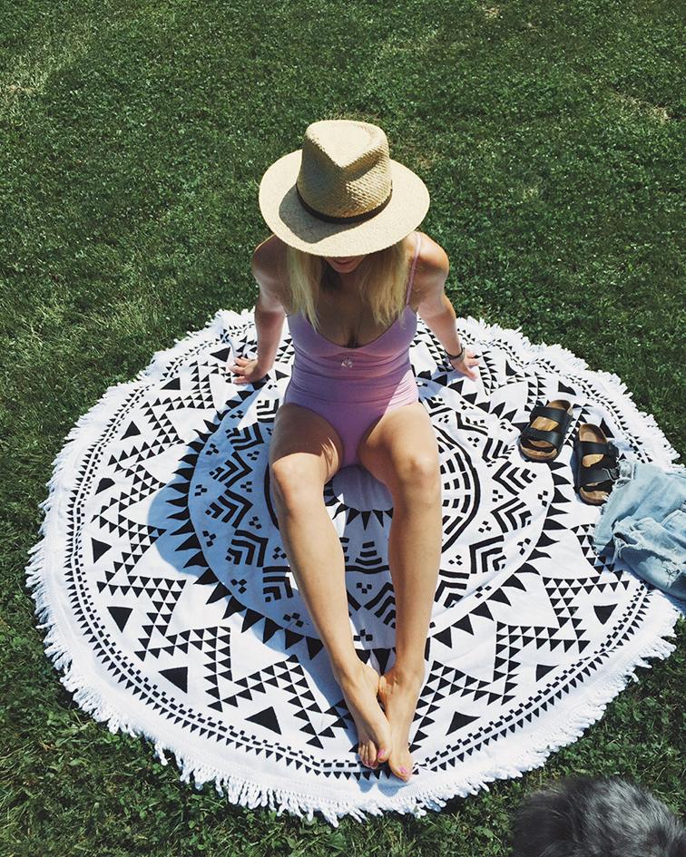 J.Crew one-piece v-neck pink swimsuit, We Are Summer round Marfa throw, Birkenstock, Dorfman Pacific straw hat
