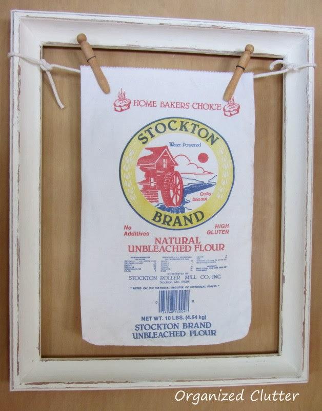 Framed Flour Sack www.organizedclutterqueen.blogspot.com