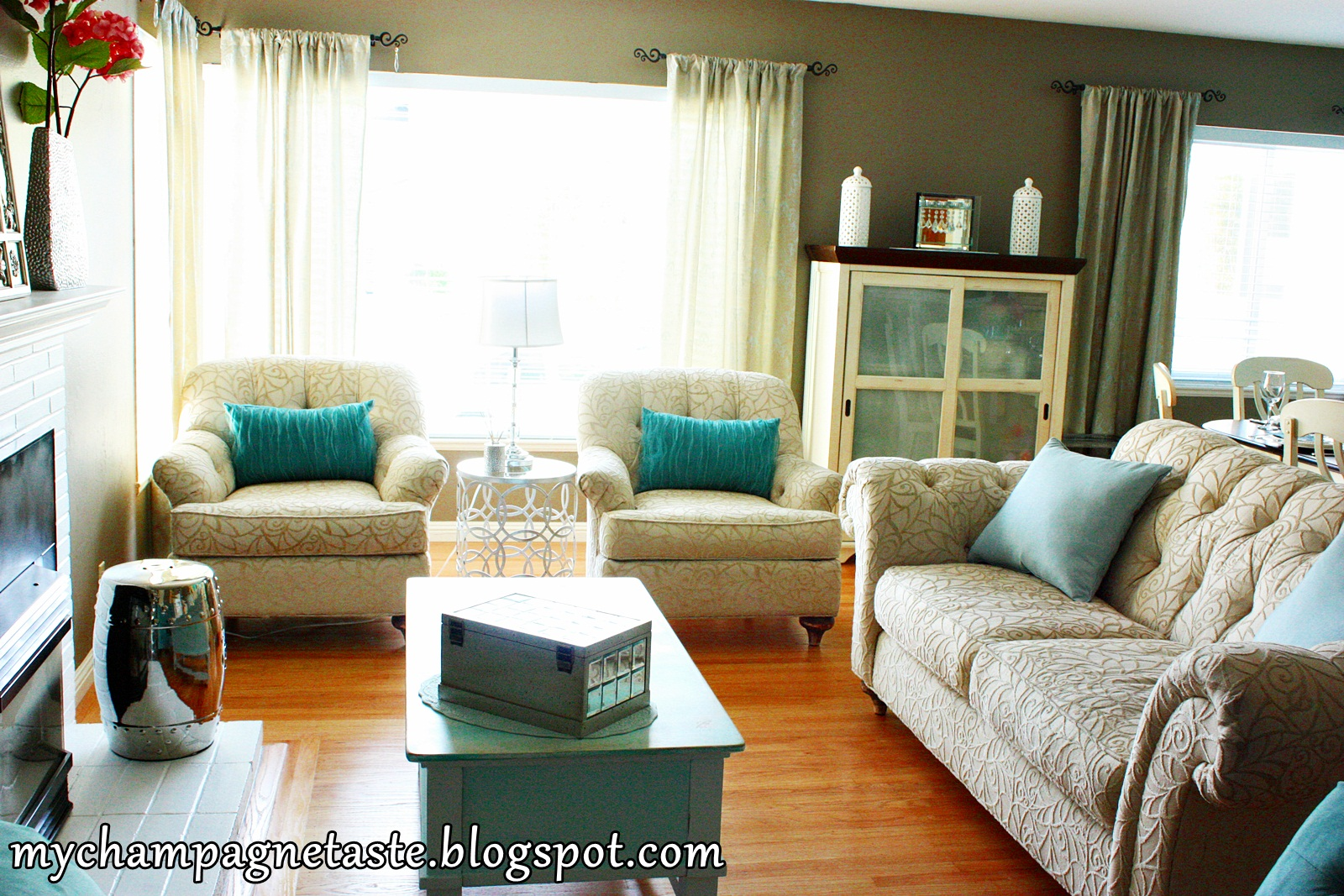 champagne taste turquoise living and dining room