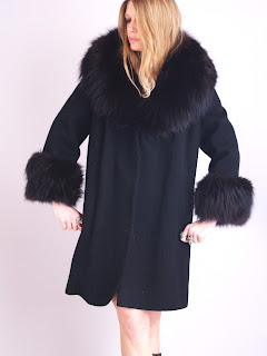 Vintage 1950's black wool swing coat with matching fox fur collar and cuffs.