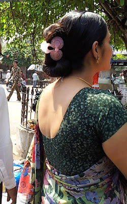 Kerala aunt from Trissur with her hair tied in bun with tight hair clip.