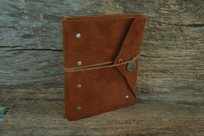 https://www.etsy.com/listing/248453386/rust-rivets-hand-bound-leather-journal-5?ref=related-0