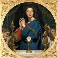 La Virgen adorando la Eucaristía