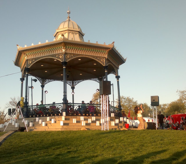 Adelaide's Elder Park Rotunda viewed from the Torrens River side.  Inside the rotunda is a 7 piece band and the lead singer is dancing and singing on the lawn in front of the rotunda which is on the right hand side in this photograph.