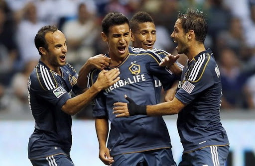 Jose Villarreal celebrates his goal against the Vancouver Whitecaps with LA Galaxy teammates