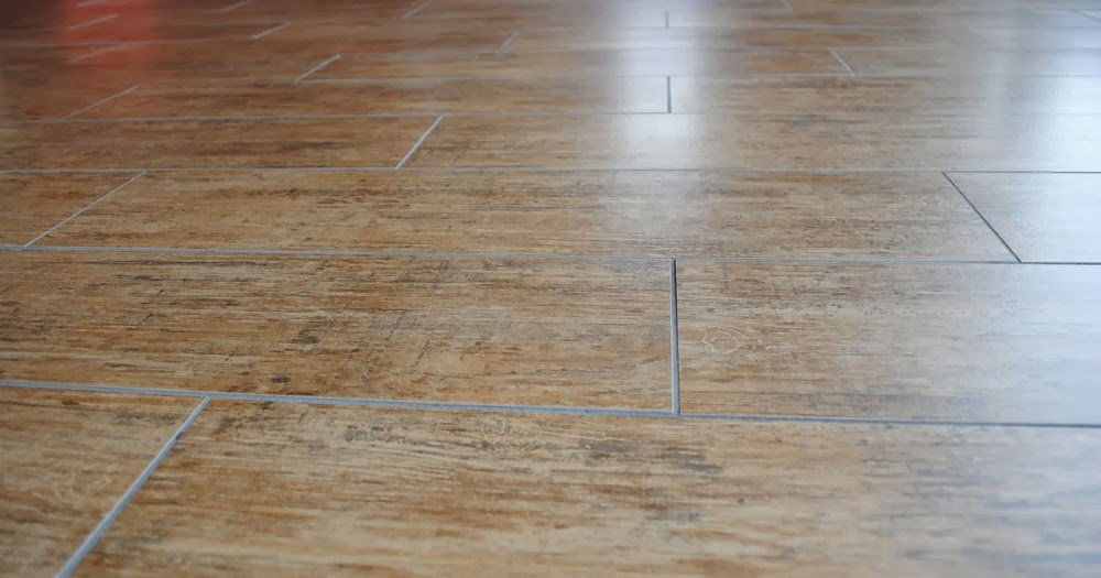 Real wood tiles vs tiles that look like wood flooring for Hardwood floors vs tile