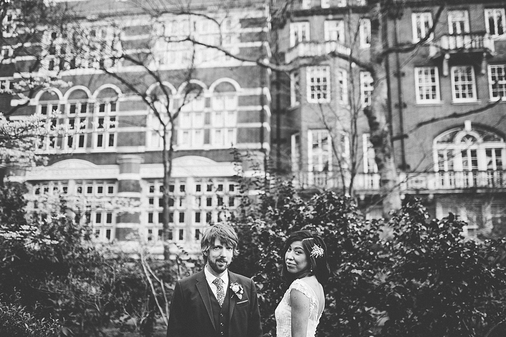 bride and groom looking at camera in mayfair wedding photography